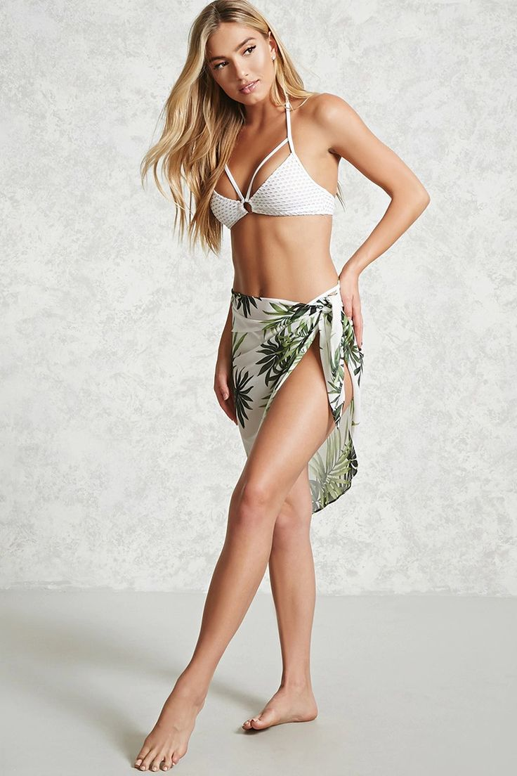 A semi-sheer, woven sarong cover-up featuring an allover leaf print and a self-tie front.