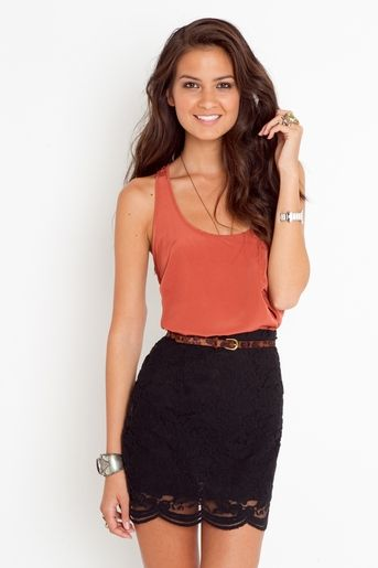 Black laced skirt with orange tank top. Love this skirt!