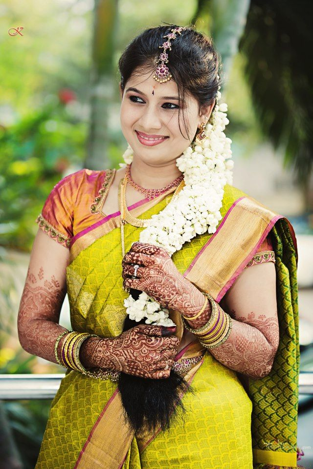 Traditional Southern Indian bride wearing bridal silk saree, jewellery and hairstyle. Temple jewelry. Jhumkis. Silk kanchipuram sari. Braid with fresh flowers. Tamil bride. Telugu bride. Kannada bride. Hindu bride. Malayalee bride. Indian Bridal Makeup. Indian Bridal Fashion. Yadhu Photography