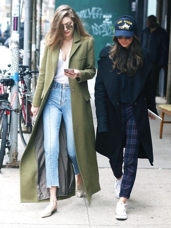 Gigi Hadid's reworked skinny jeans, white jersey top, long khaki green coat, and pointed ballet pumps give an old outfit idea a new lease on life.