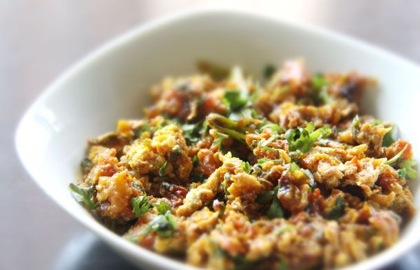 Anda Bhurji - Spicy Indian Scrambled Eggs (vegetable oil, medium onion, medium tomatoes, green chilli peppers, ginger-garlic paste, red chilli powder, turmeric powder, 4 eggs whisked lightly, salt, parsley/ cilantro and butter)