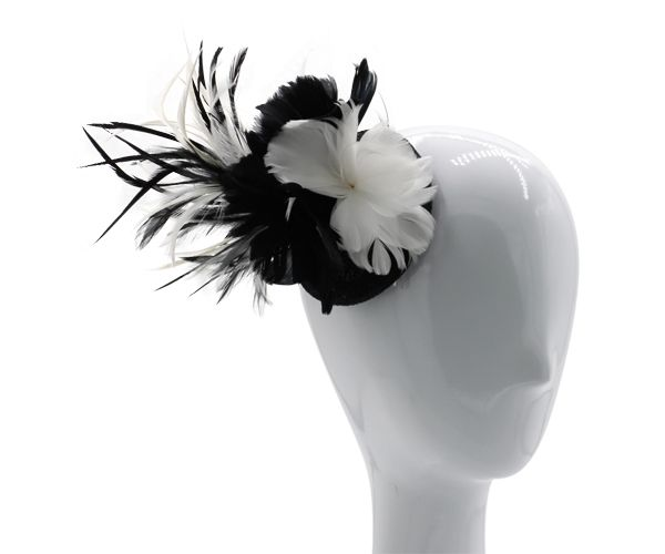 Rich jet black and pure white feather fascinator