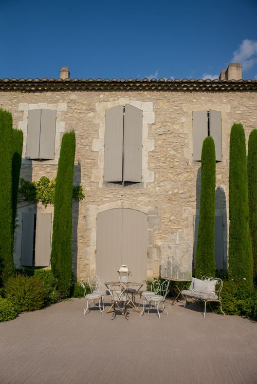 Cupressus semperviren 'Pyramidalis' grown up against the house - Summertime in Provence