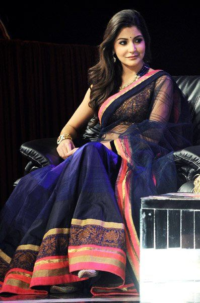 Love that the saree is stiff, making it fall ever so gracefully. And brilliant combination - ink blue, pink and gold. --- Anushka Sharma in a Manish Malhotra saree. #indian #wedding