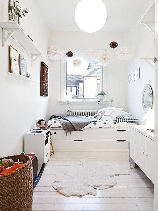Under-bed storage is essential in a small bedroom - keeping it white is a clever way to visually maximize the space! www.homeology.co.za