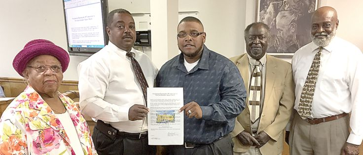 The Madison County Board of County Commissioners passed a proclamation honoring NEW ZION MISSIONARY BAPTIST CHURCH'S 150th Anniversary. Pictured, from left to right, are: Elesta Pritchett, Commissioner Alfred Martin, Rev. Keith Cloud, James Bruton, and Gary Glee.