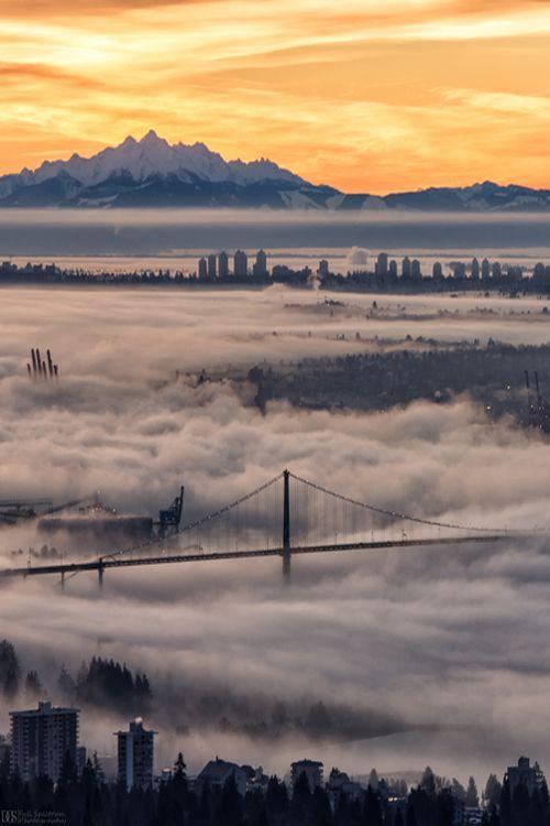 Illusion Wanderer, Fog sits over Vancouver's Lionsgate Bridge, as...