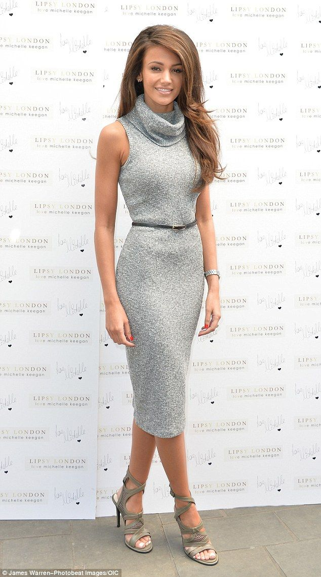 Gorgeous girl: The 27-year-old accentuated her trim hourglass curves in the very snug, grey knitted dress