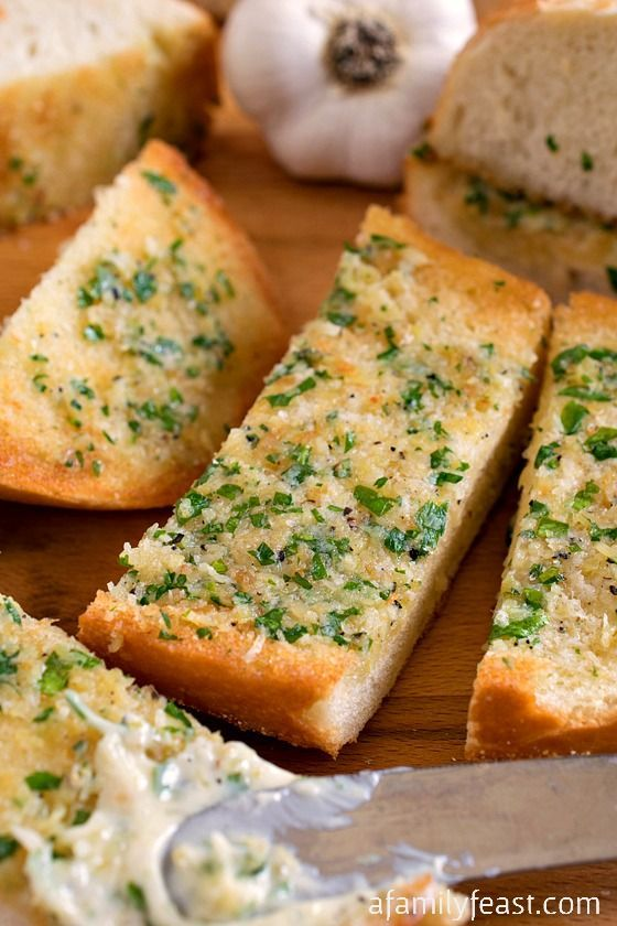 Garlic Bread - A classic recipe that everyone should have in their recipe collection!  Buttery, cheesy, garlic-y heaven!