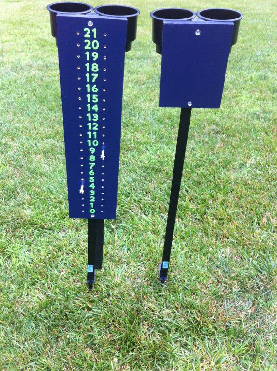 Cornhole scoreboard with beverage holder along with opposite side with beverage holder.