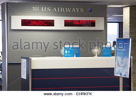 Download this stock image: US Airways check in desk at Memphis International Airport, Tennessee USA - EHRKFK from Alamys library of millions of high resolution stock photos, Stock Photo, illustrations and vectors.