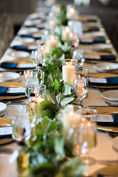 Italian wedding favors, bottles of olive oil infused with rosemary wedding favors, navy and gold wedding details, such a beautiful wedding with candles and greenery along the Mississippi river by Tiffany Brubaker Photography, La Crosse, WI