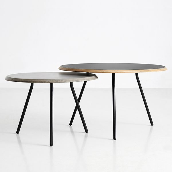 Soround from Woud is a modern, round coffee table that was designed by the Danish design studio NUR. The top rests on three slender metal legs and has a stylish, slightly slanted edge.