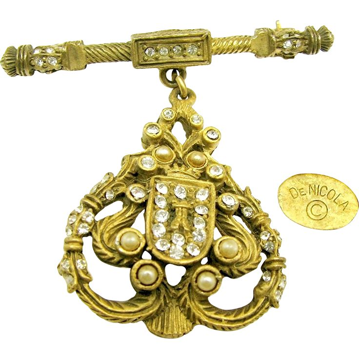 """A vintage DeNicola ornate and regal shield brooch done in the style of a Georgian era banner carried before royalty, encrusted with faux seed pearls and 'diamond' look rhinestones is from his 1950's the """"The Real Look Collection"""" and it is in excellent vintage condition check it out with the scan able photos at brendastreasures from rubylane.com!"""