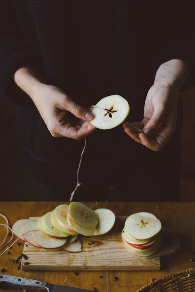 Stringing apples for drying??  In the middle you see a star if you slice them correctly.  remember to do this Mary