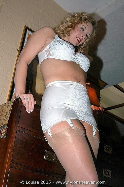 ladies in corsets spank