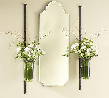 flower vases to flank a mirror... but then you have to keep fresh flowers all the time ...?