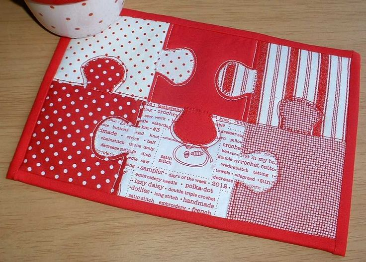 """Jigsaw Mug Rug in red and white.   Nice for the """"puzzler"""" in your family.  We have a couple in our family.  :)"""