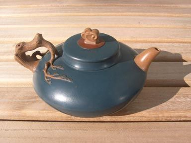 Yi Xing tea pot.  Yi Xing is the pottery capital of China.  The city is known their clay tea pots made specifically for Black or Oolong tea.