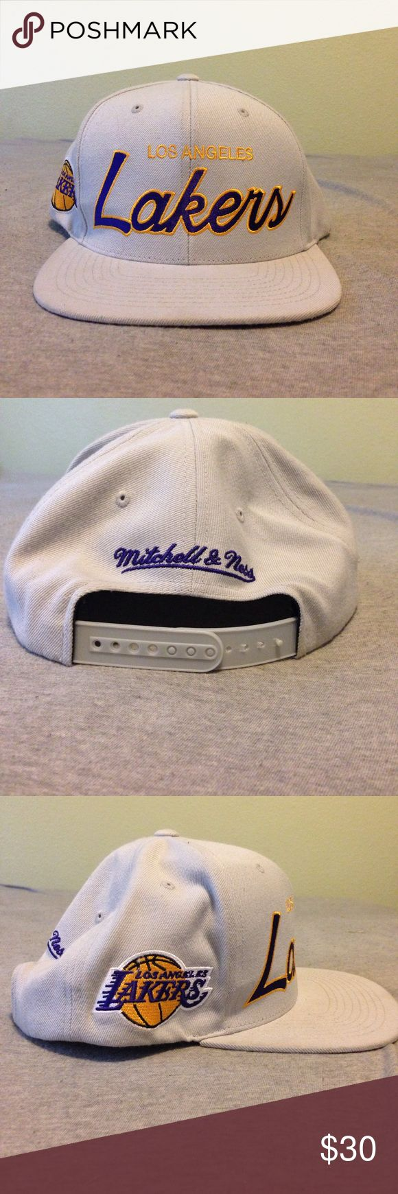 Gray Los Angeles Laker Flat Bill SnapBack. Brand new SnapBack LA Laker hat. One size fits all. No damage! Mitchell & Ness Accessories Hats