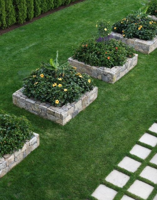 Stone raised flower beds. These would be nice at the curb, allowing entrance to the yard from the street while defining the yard's edge.