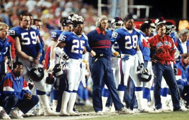 Great photo of the 1990 Super Bowl Giants sideline. Phil Simms, Marc Collins, Bill Parcells, Everson Walls, Bill Belichick, Romeo Crennel, Ron Erhardt.
