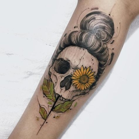 46 The sunflower tattoo with a female skull on the leg