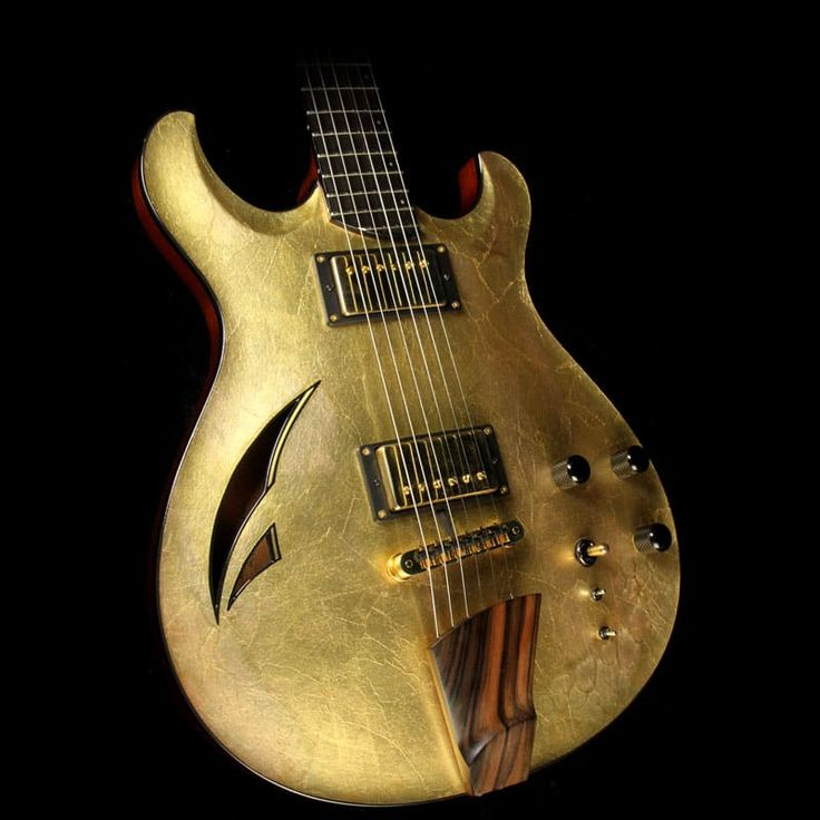This  unique and great looking guitar is a pre-owned Artinger Custom model  with a gold leaf top finish and a red stain to the back of the body,  with a mahogany neck, ebony board, and two Duncan '59 humbucker pickups  with a wooden tailpiece and adjustable bridge. The guitar has a GK  picku...