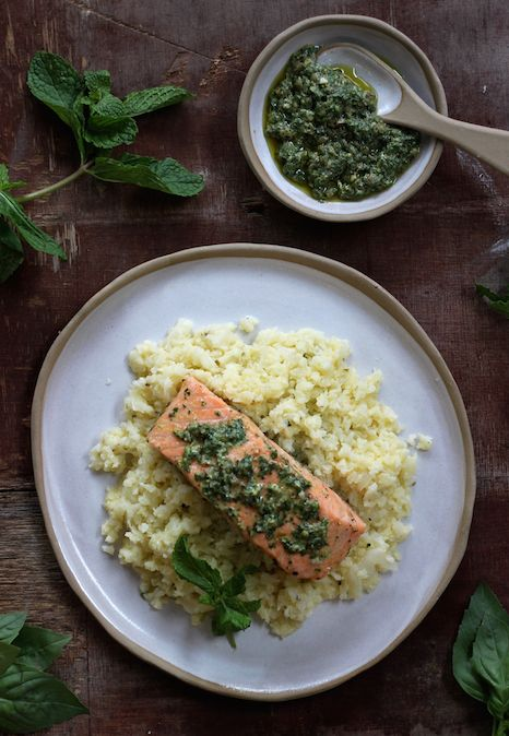 BAKED SALMON WITH CAULIFLOWER MASH & SALSA VERDE. The finest Australian salmon topped with a salsa verda made with basil, mint, capers, garlic and dijon mustard. Served with a mashed cauliflower that tastes similar to mashed potatoes but with fewer carbs. Packed full of flavour, this is a healthy must try dish.   30 Minutes. Gluten Free. Just 442 Calories Per Person