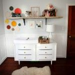 Love the changing table and wall decor