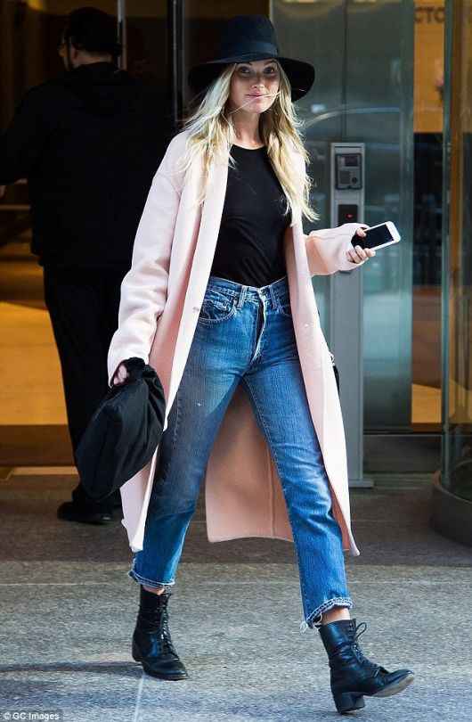 Pastel coats are big this year, especially Europe, but the boots and jeans toughen up the look! Cute!