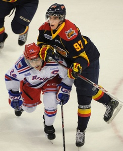 Erie Otters forward Connor McDavid leans on Kitchener captain Ryan Murphy in recent action at the Aud.
