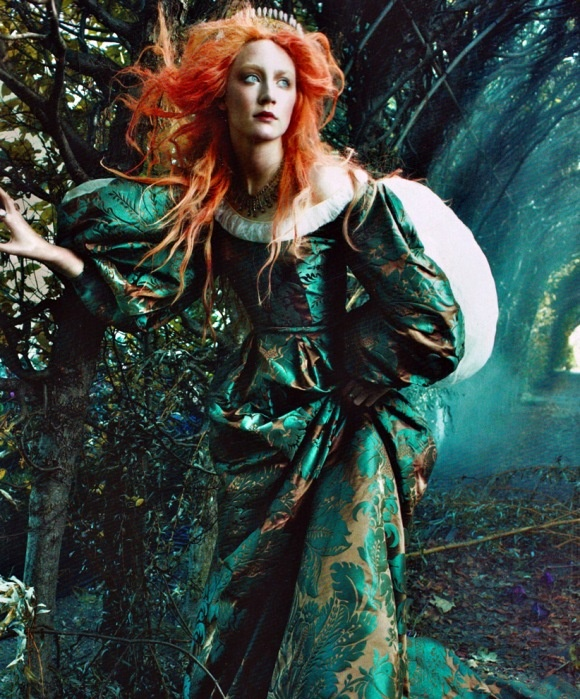 Saoirse Ronan was featured in a Vogue article about Pre-raphaelite art. In this photograph she is depicted as a recreation of a pre-raphaelite painting.