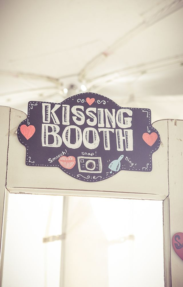 DIY Kissing Booth using a door - photo by New Vintage Media