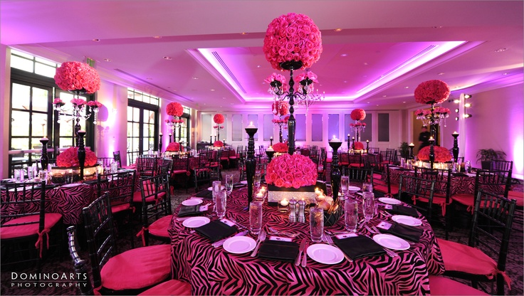 #Nancy #Gilbert of @Xquisite Events took charge of the vibrant décor of black and pink zebra table linens, #centerpieces with hot #pink #roses and crystals, and hot pink seat cushions. Dale #Mclean of #DJM Star Time #Entertainment truly is the Master of the Mic, and undoubtedly displayed his talent and ability to pump up the crowd at Julia's #Bat #Mitzvah. #Mitzvah #decoration picture by #DominoArts #Photography (www.DominoArts.com)