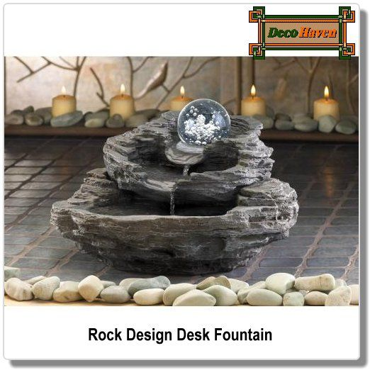 Rock Design Desk Fountain - Rock design desk table fountain featuring a spinning clear orb and three tiers. Water cascades from beneath the gently spinning orb, showering the rocklike tiers below.  Only $44.96 plus FREE shipping!