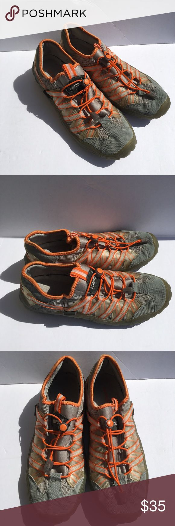 Speedo Mens Shoes Size 9 Water Sneaker Gray Orange This listing is for a pair of men's Speedo water shoes. They are size 9 and are gray with orange accents.  The laces are adjusted via pull tab for easy on/off. Speedo Shoes