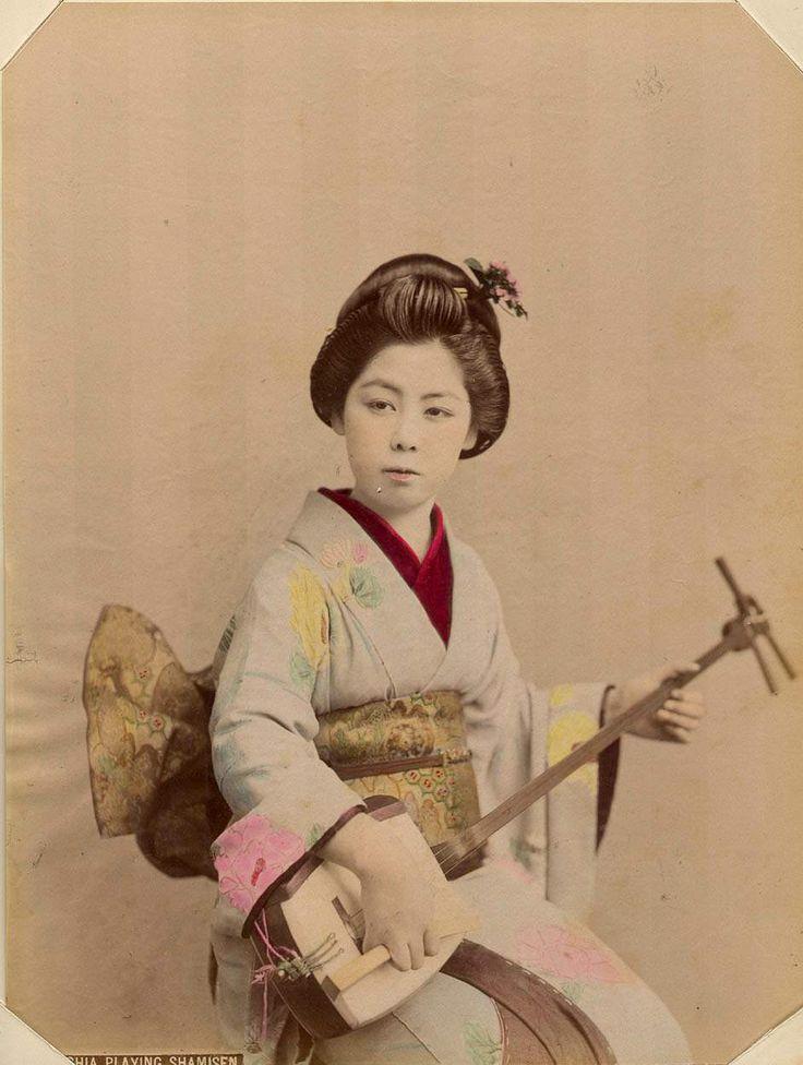 Geisha Playing Shamisen. (Photo by Kusakabe Kimbei)
