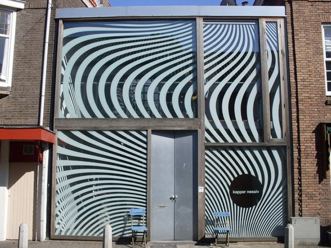This graphic window illustration by SPIELEREI is based on waving hair. It's not only designed to attract attention but also to give clients some privacy and keep the inside of the shop cool by blocking the sun for 50%.