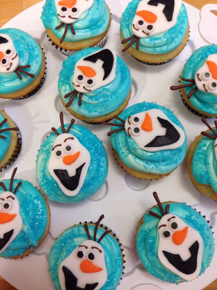 Olaf cupcakes from Disney's Frozen. Character made with fondant and candy melt accents.