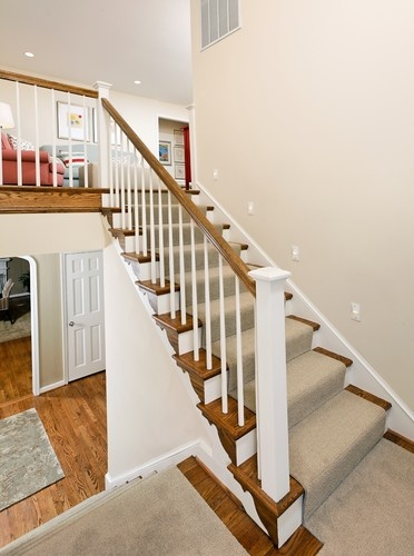 split level stairs with carpet runner, step light (halo recessed step light @ Home Depot)
