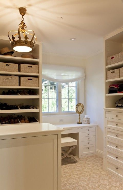 The 25 best closet chandelier ideas on pinterest master closet fabulous closet features gold crown chandelier illuminating closet island across from built in shelving housing folded sweaters stacked atop built in aloadofball Image collections