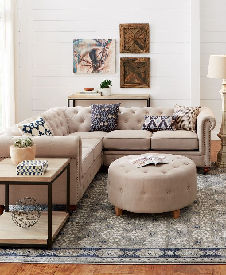 Not your average sectional, this Chesterfield-style piece has ample seating  and beautiful details