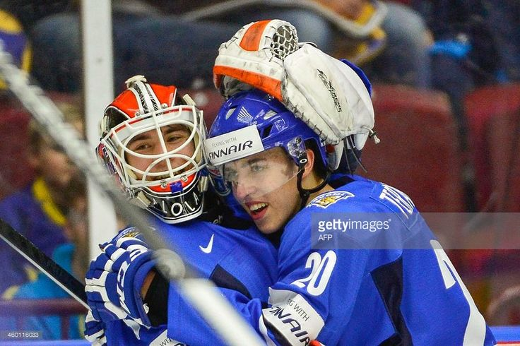 Finland's Teuvo Teravainen (R) hugs the goalie Juuse Saros after the victory by 5-3 in the World Junior Hockey Championships quarter final between Finland and Czech Republic at the Malmo Arena in Malmo, Sweden, on January 2, 2014.