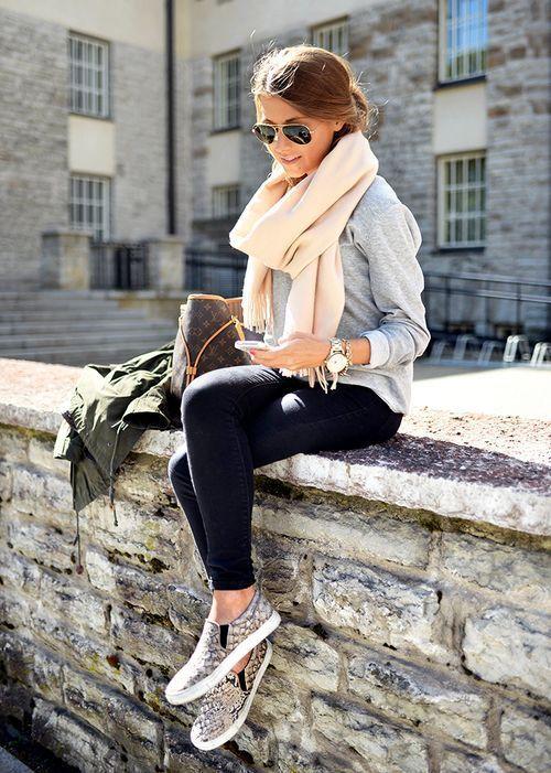 Gray sweatshirt, cashmere scarf, dark skinny jeans, flats, olive jacket, and large sunglasses.
