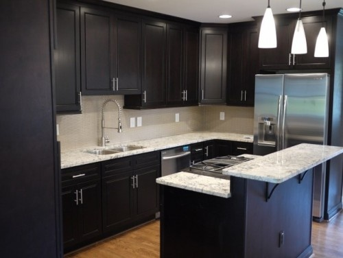 Black cabinets white countertops if i knock out one wall for Long kitchen wall units