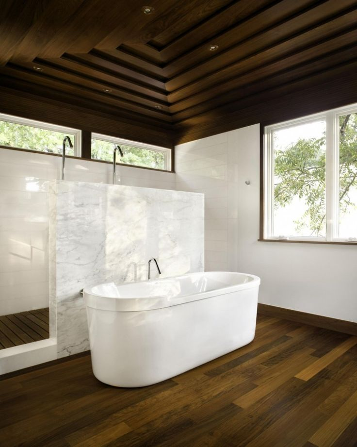 Contemporary House Design in Austin, Texas: White Bathtub In Fantastic Bathroom Ideas Design With Dark Wooden Floor And Glass Window Also Wooden Ceiling With Stainless Steel Shower And White Wall Plus Ceiling Lighting ~ jangrue.com Architecture Inspiration