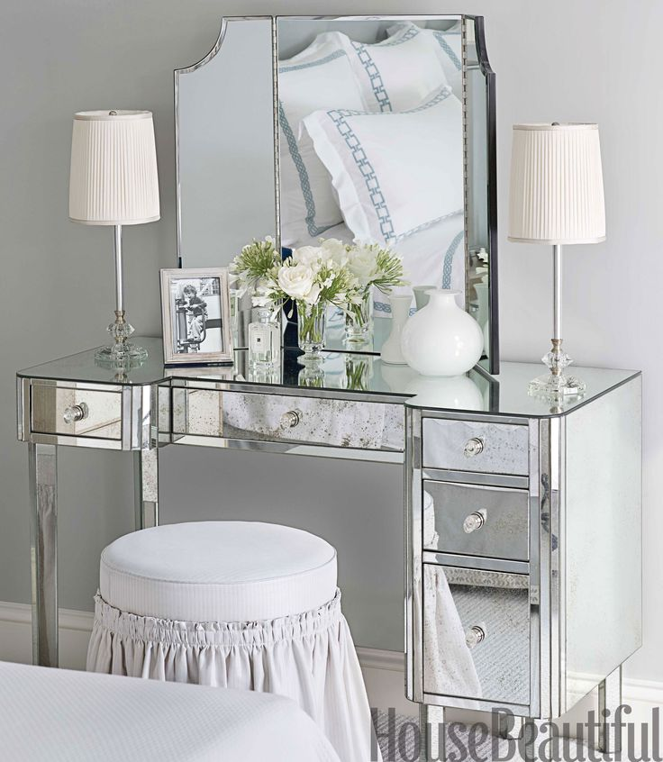 A mirrored dressing table offers another place to put on makeup. 1930s table lamps from Chameleon Fine Lighting.   - HouseBeautiful.com