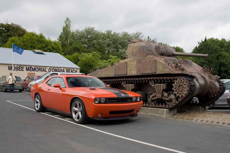 Dodge Challenger vs. tank. Caption this! http//www