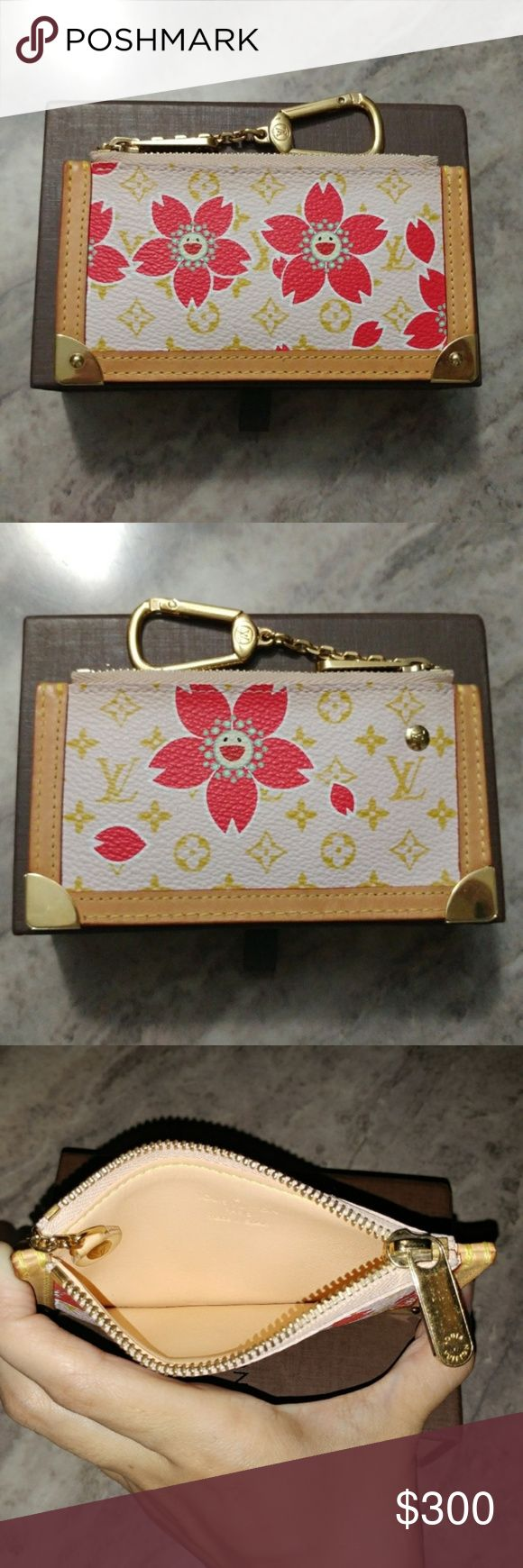 100% AUTHENTIC LOUIS VUITTON COIN PURSE RARE! + 100% AUTHENTIC GUARANTEED. I NEVER SELL OR BUY FAKES! + SERIAL NUMBER IS CA0053 AND IS ALSO STAMPED ON THE INSIDE OF THE PIECE. + FROM CHERRY BLOSSOM COLLECTION BY TAKASHI MURAKAMI. SUPER HARD TO FIND! + NEARLY PERFECT CONDITION AFTER 14+ YEARS! + MAKE PRACTICAL OFFERS. NO LOW BALLING ALLOWED! + I NEVER TRADE! Louis Vuitton Bags Wallets